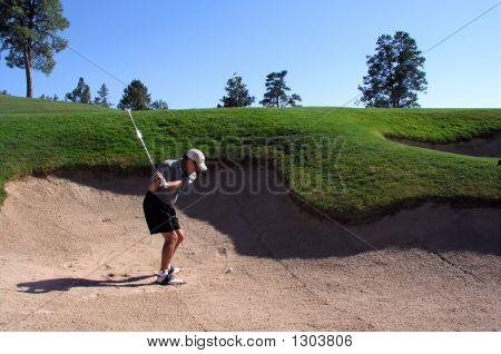 Golfer Hitting Out Of A Sand Trap (1 Of 3 Shot Action Sequence)