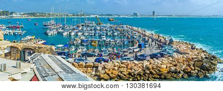 ACRE ISRAEL - FEBRUARY 20 2016: The sailing yachts and the fish boats in marina of Akko one of the best city locations on February 20 in Acre.