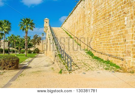 The massive city wall of Akko is neighboring with the Hafir Garden Israel.