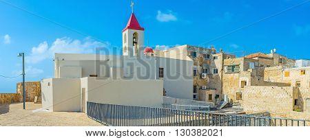 The white St John's church is the popular tourist landmark in old Akko Israel.