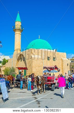 ACRE ISRAEL - FEBRUARY 20 2016: The carriage with a horse next to Sinan Basha Sea Mosque located in old port district on February 20 in Acre.