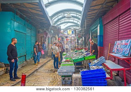 ACRE ISRAEL - FEBRUARY 20 2016: The Turkish Bazaar is the place of tourist interest people watch the local goods buy cheap eats and souvenirs on February 20 in Acre.