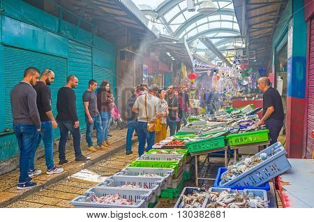 ACRE ISRAEL - FEBRUARY 20 2016: The fish stall in the covered Turkish Bazaar attracts the tourists on February 20 in Acre.