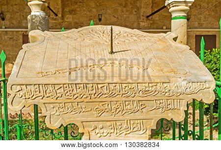 ACRE ISRAEL - FEBRUARY 20 2016: The stone sundial in the courtyard of Al-Jazzar mosque decorated with arabic calligraphy on February 20 in Acre.