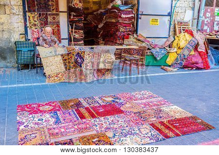 TEL AVIV ISRAEL - FEBRUARY 25 2016: The beautiful patchwork rugs made out of vintage kilim remnants in the flea market of Jaffa on February 25 in Tel Aviv.