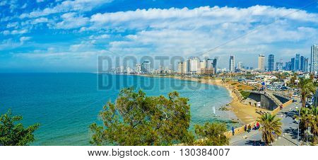 TEL AVIV ISRAEL - FEBBRUARY 25 2016: Panorama of the coast with the comfortable sand beaches modern luxury hotels and scenic promenade on February 25 in Tel Aviv.