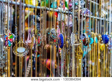 TEL AVIV ISRAEL - FEBBRUARY 25 2016: The pendants and lockets in the jewelry stall of the Jaffa flea market on February 25 in Tel Aviv.