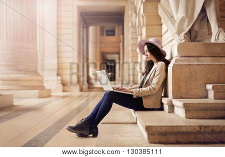 Elegant woman using her pc