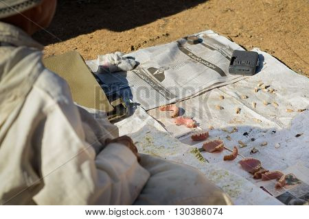 GUELMIM MOROCCO - OCTOBER 31 2015: Man with collection of false teeth for sale at the weekly market in the south Moroccan town of Guelmim.