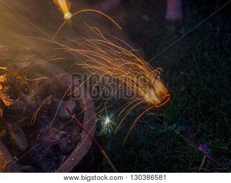 sparks flying close to a comforting fire