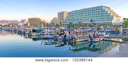 EILAT ISRAEL - FEBRUARY 23 2016: The fresh evening air and nice cityscape make port the perfect place for the walks on February 23 in Eilat.