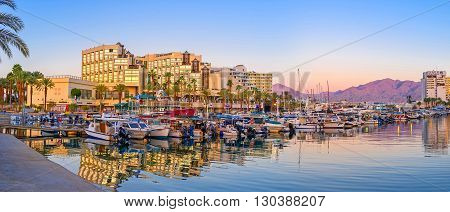 EILAT ISRAEL - FEBRUARY 23 2016: The picturesque evening port with many yachts and fishing boats waiting for the trips on February 23 in Eilat.