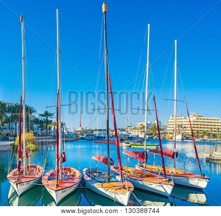 EILAT ISRAEL - FEBRUARY 24 2016: The sailing yachts are popular in resort on February 24 in Eilat.