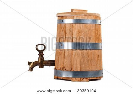 Oak barrel with a copper crane isolated on white background