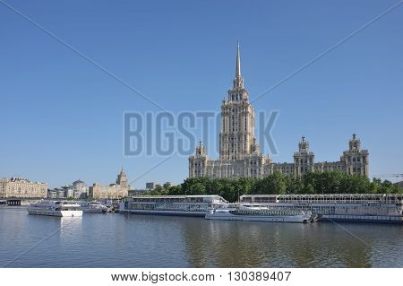 MOSCOW, RUSSIA - MAY 13, 2016: View of the hotel Ukraine and pier Taras Shevchenko of the Moskva river landmark cityscape