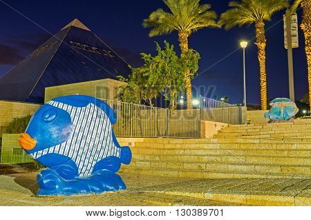 EILAT ISRAEL - FEBRUARY 23 2016: The square in front of Historic Museum decorated with the different sculptures of fishes on February 23 in Eilat.