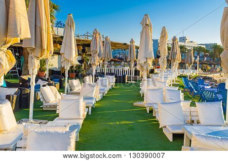 EILAT ISRAEL - FEBRUARY 24 2016: The cozy restaurant on the central beach offers the local cuisine and beverages on February 24 in Eilat.