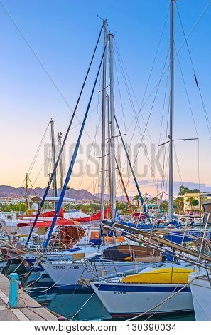 EILAT ISRAEL - FEBRUARY 23 2016: The sailing yachts moored in Lagoona make tourist trips every day on February 23 in Eilat.