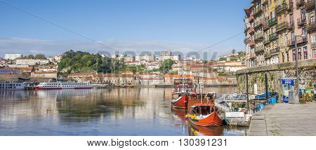 PORTO, PORTUGAL - APRIL 20, 2016: Panorama of boats at the Ribeira quay in Porto, Portugal