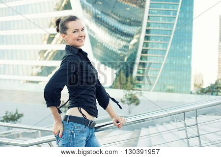 Beautiful Brunette Woman In A Modern City