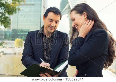 Business People Sign A Document
