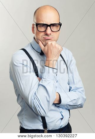 Thoughtful Bald Man In Glasses