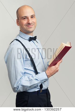 Smiling Bald Man Reading A Book