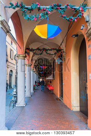 Bologna, Italy - December 27, 2015: day view of Bologna's passage way. In total there are about 38 kilometres of arcades in the city's historical centre In Bologna Italy.
