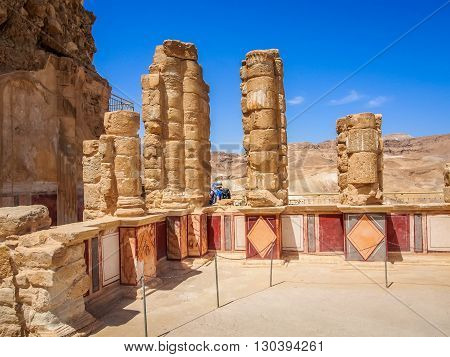 Masada fortress in Israel, ruins of ancient colonnade of King Herod's palace decorated by wall paintings