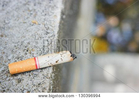 The Disposable cigarette Lay on the cement floor