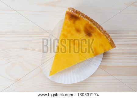 Flan at home under a wooden table