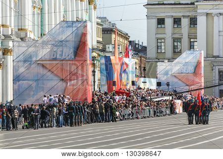 St. Petersburg, Russia - 9 May, Bearers group on Palace Square near the festive crowd, 9 May, 2016. Festive military parade on the Palace Square in St. Petersburg.