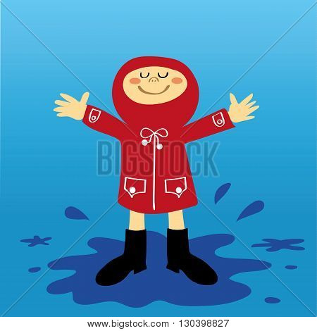 A small boy or girl in a red raincoat having fun splashing in the puddles after a shower of rain