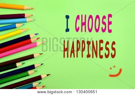 The words I choose happiness on green background