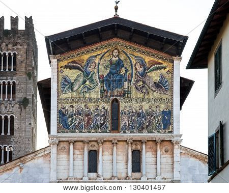 Medieval Mosaic Depicting the Ascension of Christ - with the Apostles shown below. Upper facade of the Basilica of San Frediano in Lucca Tuscany Italy and dating to the 13th century.
