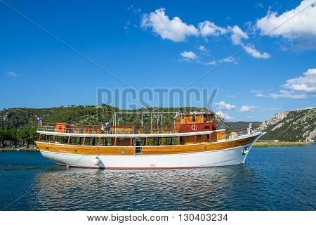 KrKa river Croatia - May 05 2016: cruise boat on Krka river near Skradin