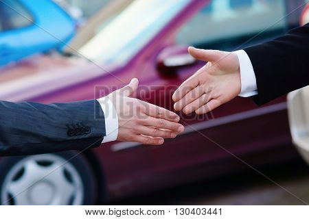 Greeting handshake in auto show or salon