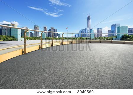 cityscape and skyline of hangzhou on view from empty asphalt road