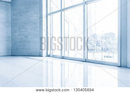 glass floor in modern building with glass windows