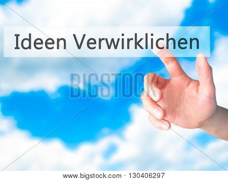 Ideen Verwirklichen ( Realize Ideas In German)  - Hand Pressing A Button On Blurred Background Conce