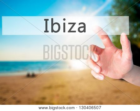 Ibiza - Hand Pressing A Button On Blurred Background Concept On Visual Screen.