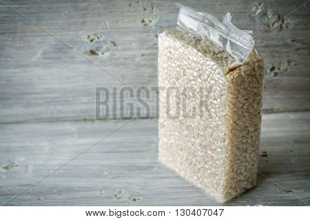 Packaging with Arborio rice on old blue boards horizontal