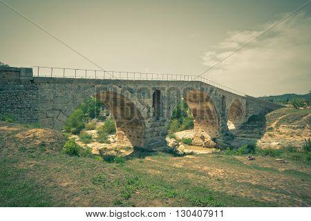 Old roman bridge Julien pont in Provence France. Filtered shot