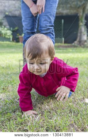 Little Girl Crawling On Grass