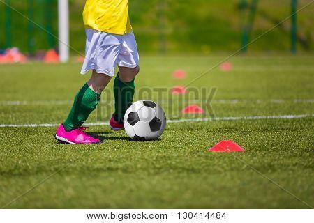 Soccer football training session for children. Boys kicking soccer ball