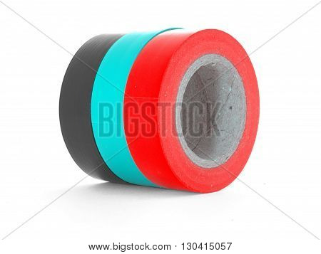 Black, cyan, red insulation tape rolls, isolated on white background