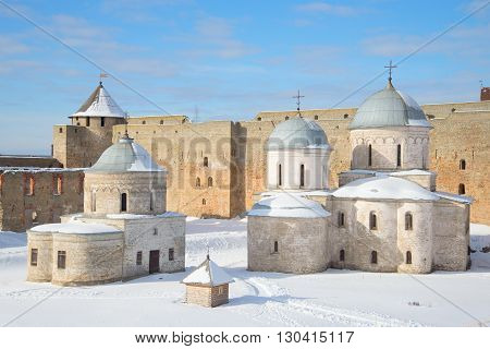 IVANGOROD, RUSSIA - MARCH 02, 2016: St. Nicholas Church and Cathedral of the assumption within the walls of the Ivangorod fortress, winter day.  Historical landmark of the Russia