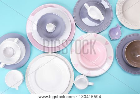Empty dishes on blue background.