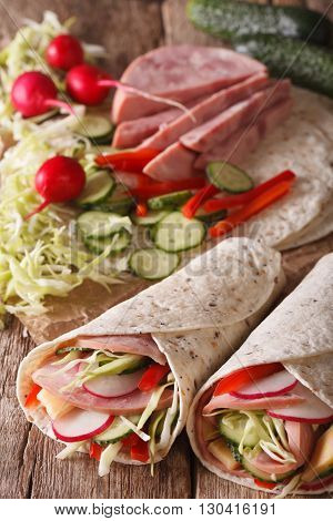 Burritos With Ham, Cheese And Fresh Vegetables Close-up. Vertical