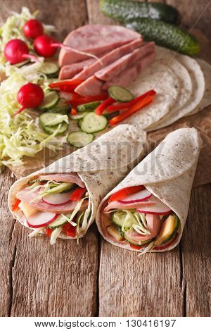 Sandwich Roll Stuffed With Ham, Cheese, Vegetables Close-up. Vertical